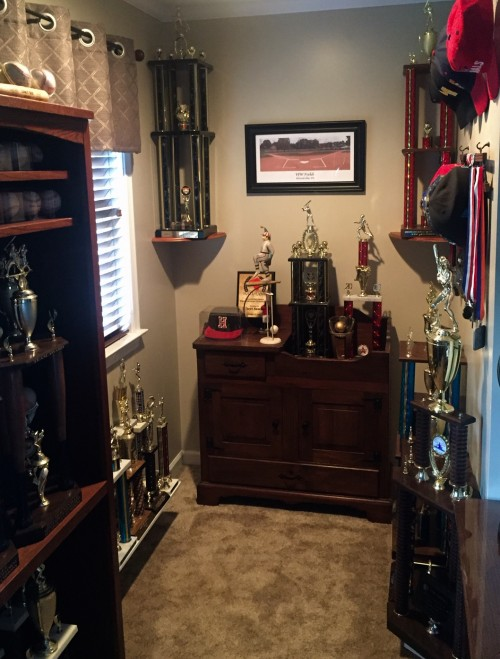 What once was a study nook in a teenager's bedroom eventually became an office trophy nook where some of the 133 trophies have found a home.